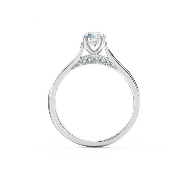 A beautiful claw set engagement ring with a unique side profile