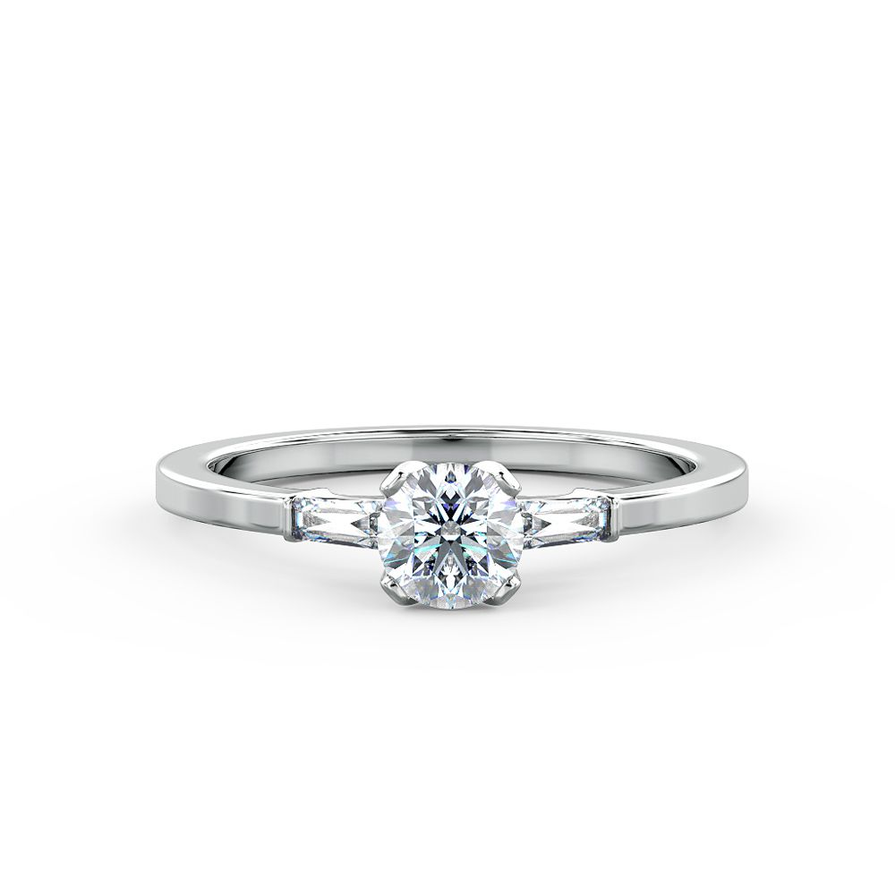 A classic engagement ring beautifully set with a round brilliant cut diamond & tapered baguettes
