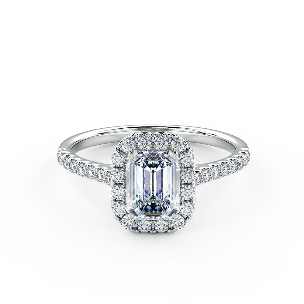 A stunning emerald diamond halo engagement ring beautifully set using a fine micro-claw