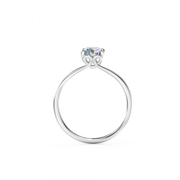 A classic engagement ring is beautifully claw set with a unique side profile