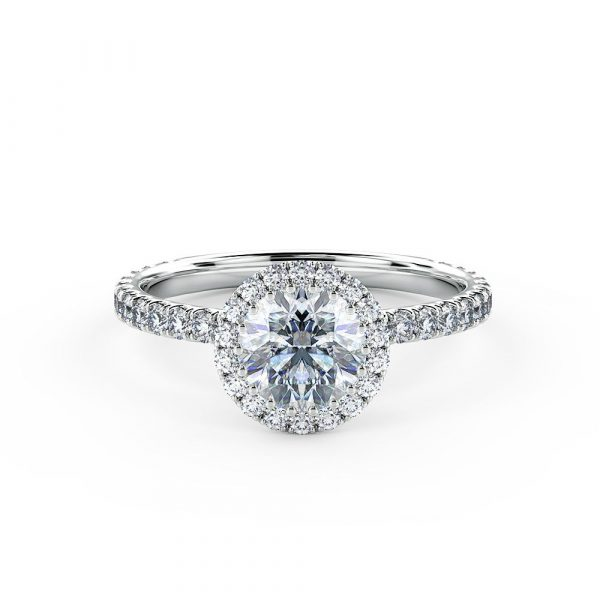 A stunning halo engagement ring is beautifully set using a fine micro-claw setting